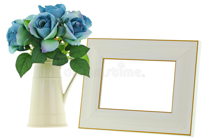 Yellow Ceramic Jug Vase Next To Blank Beige Wooden Picture Frame