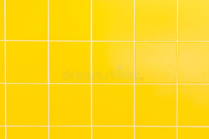 Yellow ceramic tiles background in bathroom royalty free stock photography