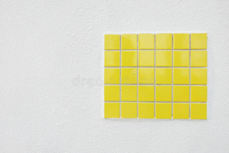 Yellow ceramic wall and floor tile abstract background. Copy space for text or logo. Square bathroom mosaic texture pattern design architecture tiled decorative royalty free stock image