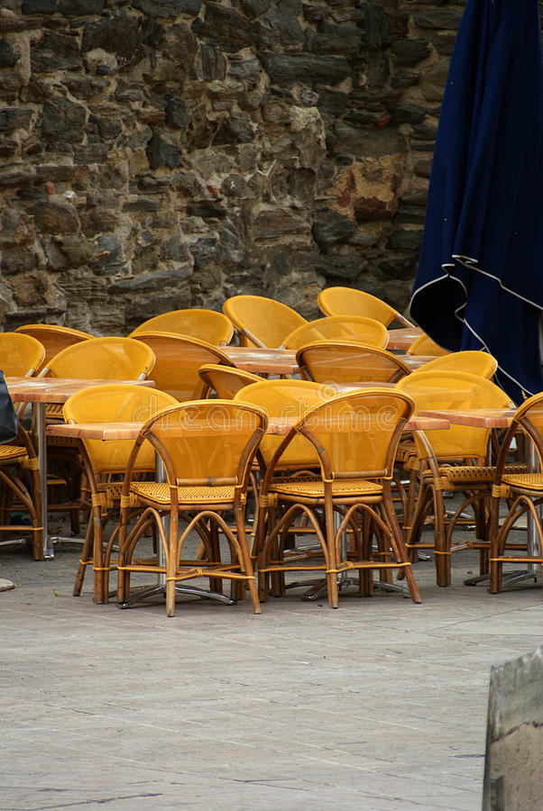 Yellow chairs. These empty yellow chairs are on a terrace in Collioure in the South of France stock images