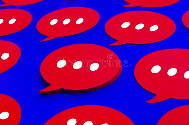 Yellow chat,speech bubble icons on blue color background.Talking and message for social media concepts royalty free stock photography