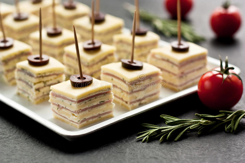 Yellow cheese and ham appetizers stock photo