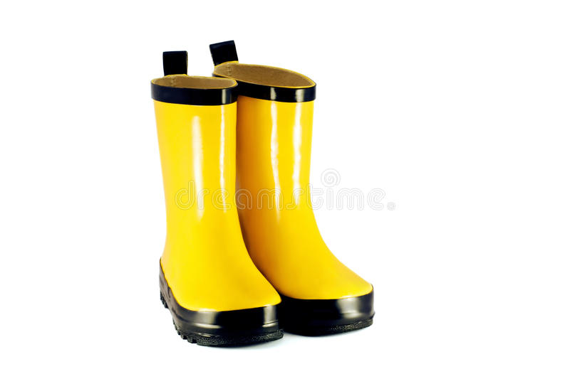 Yellow children`s boots stock images
