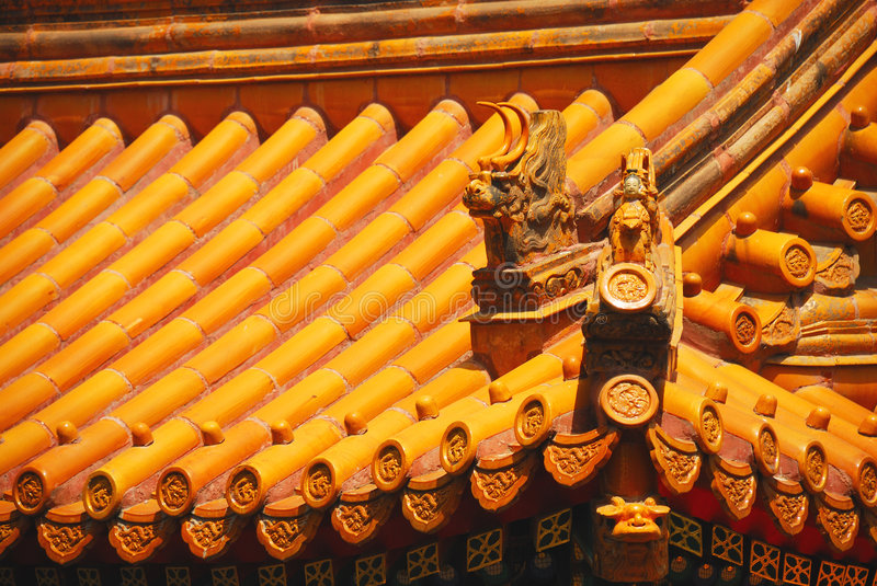 Yellow chinese temple roof. Yellow tiles of a Chinese temple roof with dragon ornaments royalty free stock images