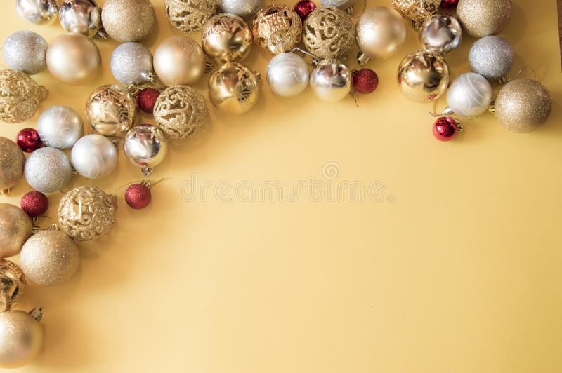 Yellow Christmas background with golden balls royalty free stock photography