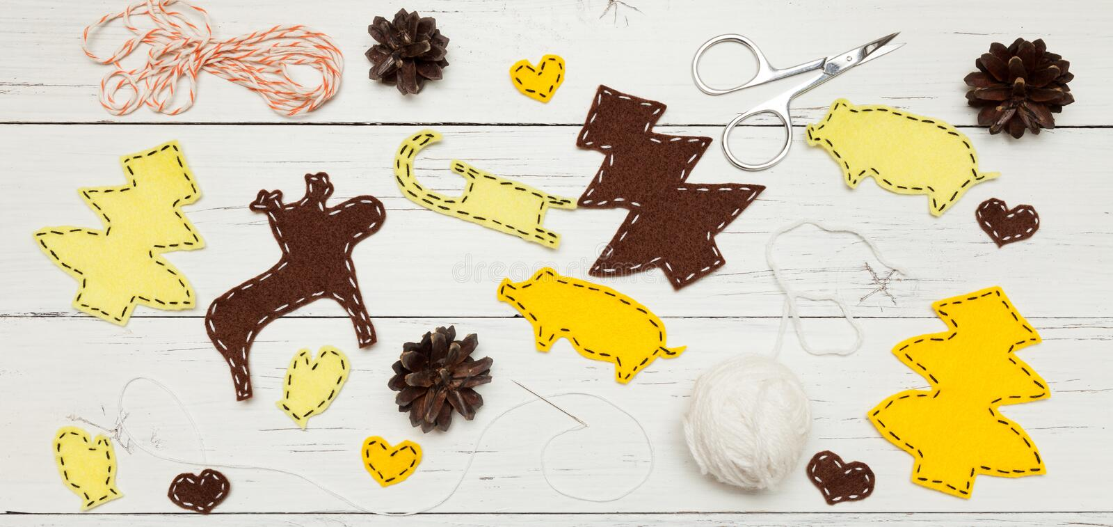 Yellow Christmas craft decorations on white table, copy space for text.  stock images