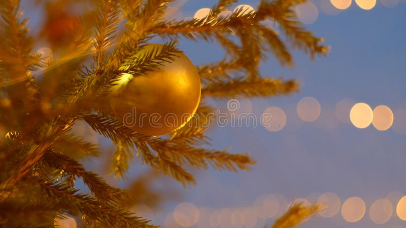 Yellow Christmas tree toy on the Christmas tree royalty free stock image