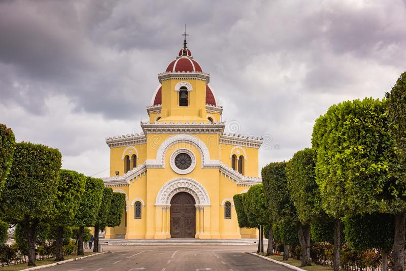 Colon Cemetary Church - Havana, Cuba. Yellow church with dome roof and tower at the Necropolis Cristobal Colon in Havana, Cuba royalty free stock images