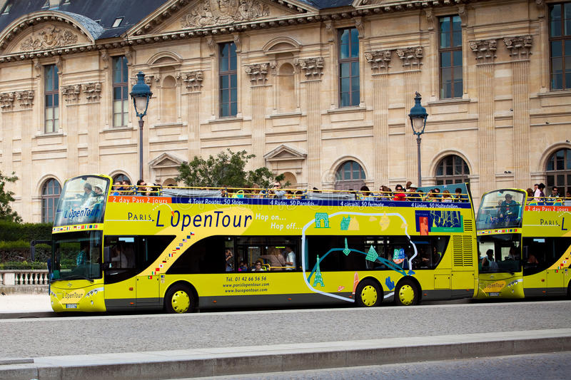 Yellow city sightseeing bus Neoplan on Paris city street. stock photo