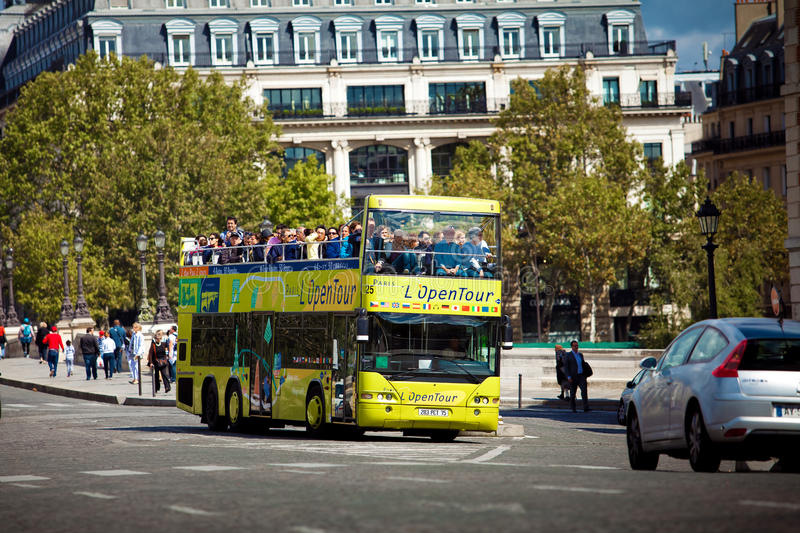 Yellow city sightseeing bus Neoplan on Paris city street. stock image