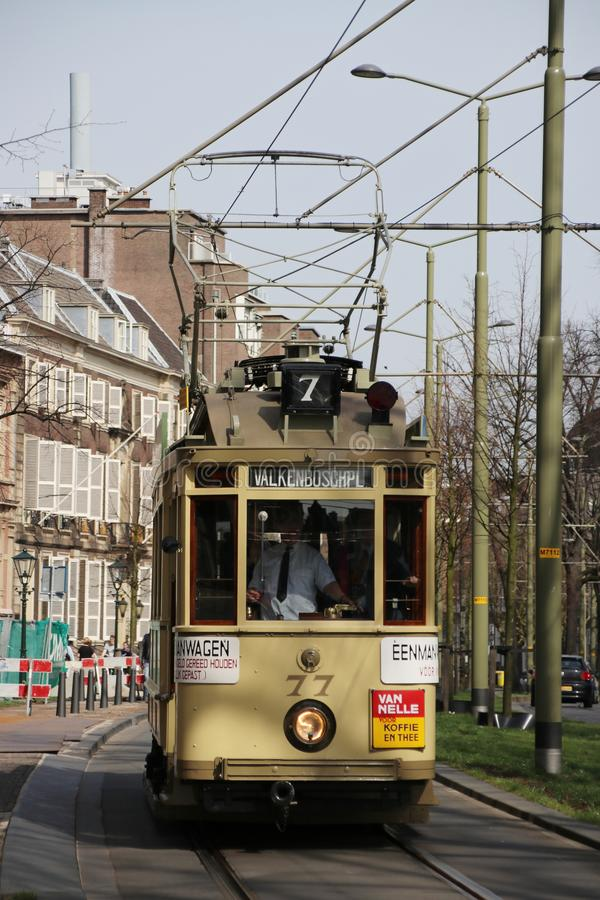 Yellow classic street car 77 named `Ombouwer` on the Vijverberg in The Hague the Netherlands stock image