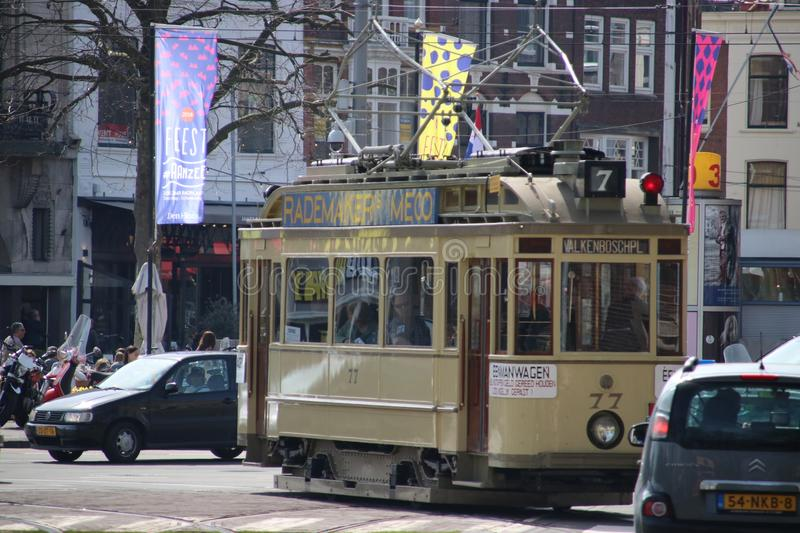 Yellow classic street car 77 named `Ombouwer` on the Vijverberg in The Hague the Netherlands royalty free stock photos