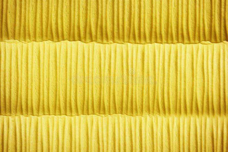 Yellow cloth sponge surface pattern stock photos