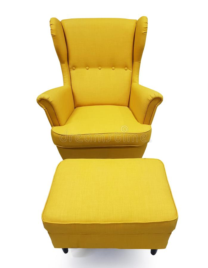 Yellow color of armchair and small chair for legs. Modern designer armchair on white background. Textile armchair and chair. Series of furniture isolated on royalty free stock photo