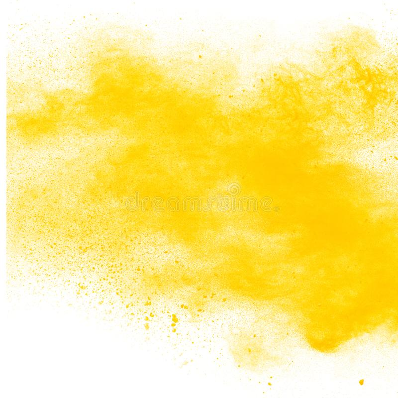 Yellow color powder explosion cloud isolated on white background. Closeup of yellow dust particles splash isolated on background stock photo