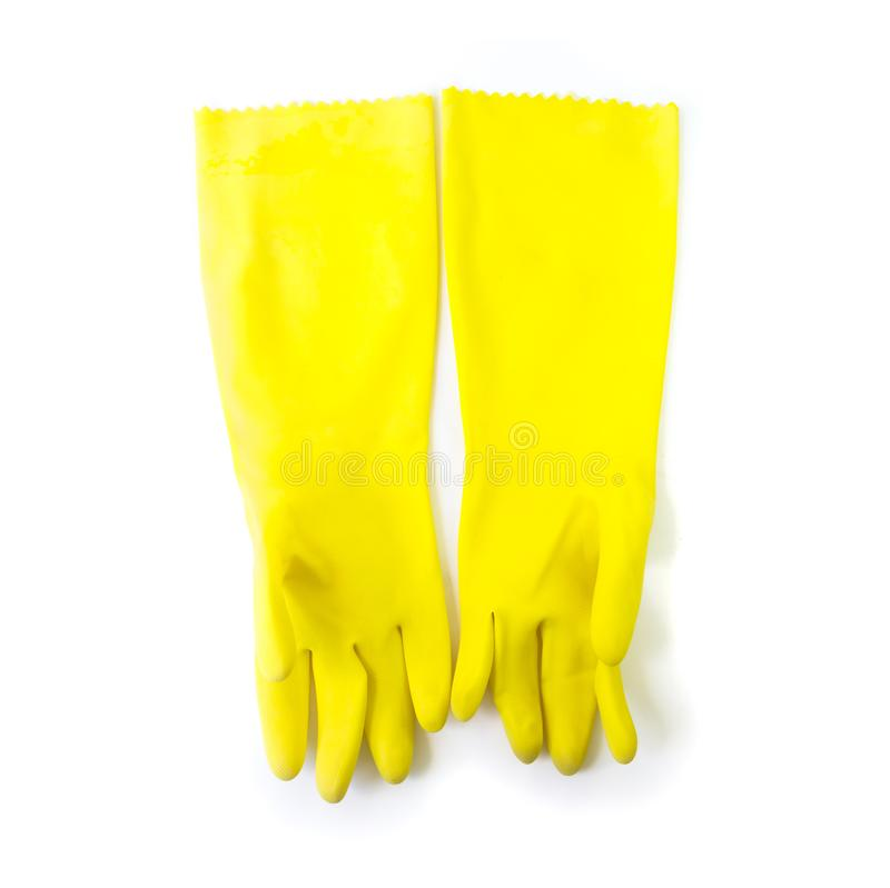 Yellow color rubber gloves for cleaning on white background, housework concept royalty free stock images