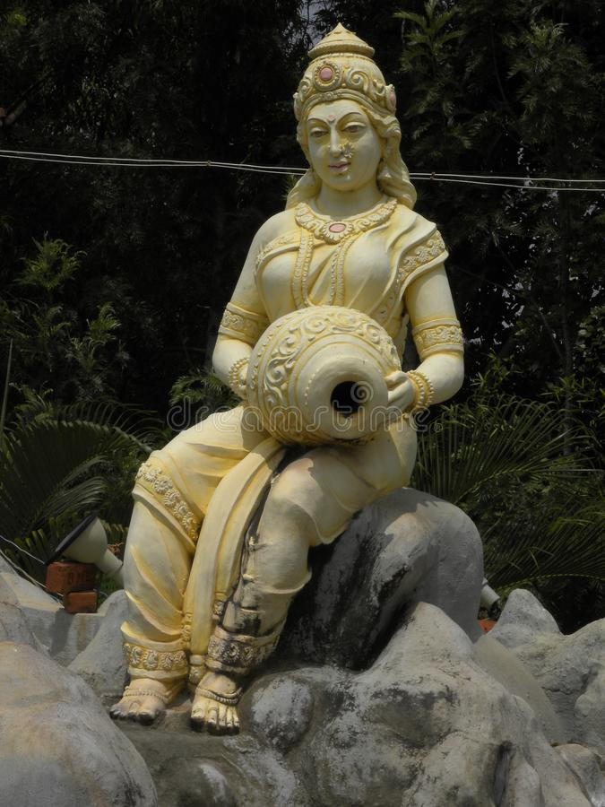 Bangalore, Karnataka, India - January 1, 2009 Yellow color statue of river goddess Ganga. Yellow color statue of river goddess Ganga sitting on a mountain at stock images