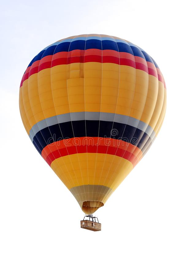 Yellow aerostat on a white background. Yellow colored aerostat in flight stock images