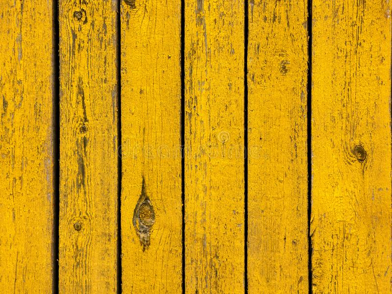 Yellow colored old wood plank texture background stock photo