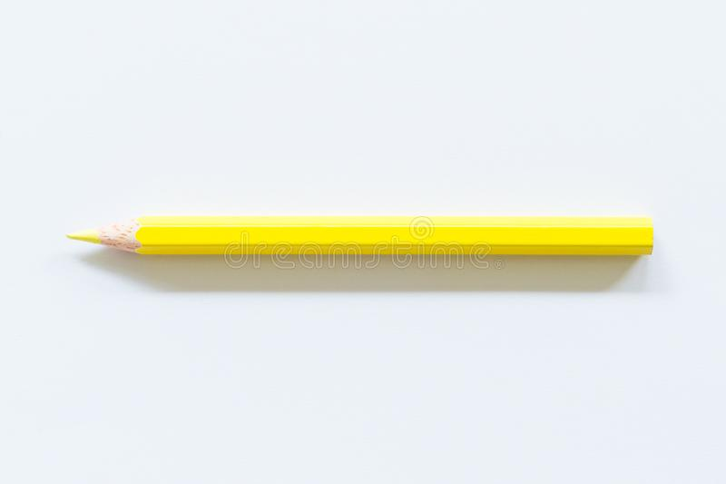 Yellow colored pencil  One single object, top view, bright tint. royalty free stock photography
