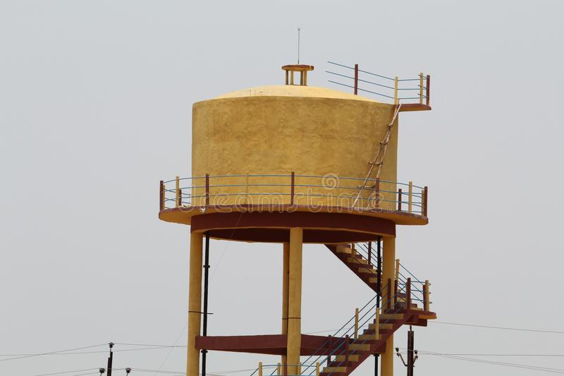 Yellow Colored Water Tank stock photo