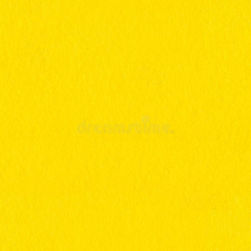 Yellow coloured felt, background. Seamless square texture. Yellow coloured felt, background. Seamless square texture, tile ready. High resolution photo stock image