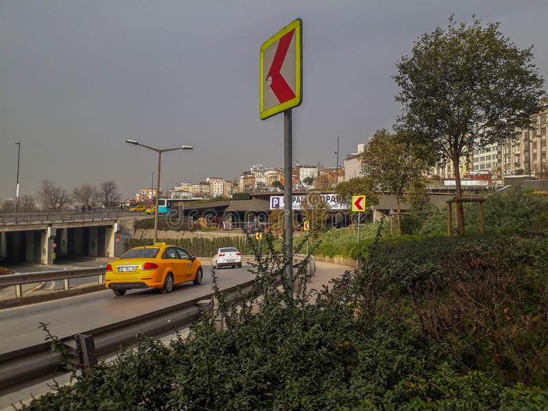 Motorway Bridge Trees in Beyoglu Istanbul. Yellow Commeracial Car Taxi in Motorway and Bridge Trees in Beyoglu Istanbul stock photography