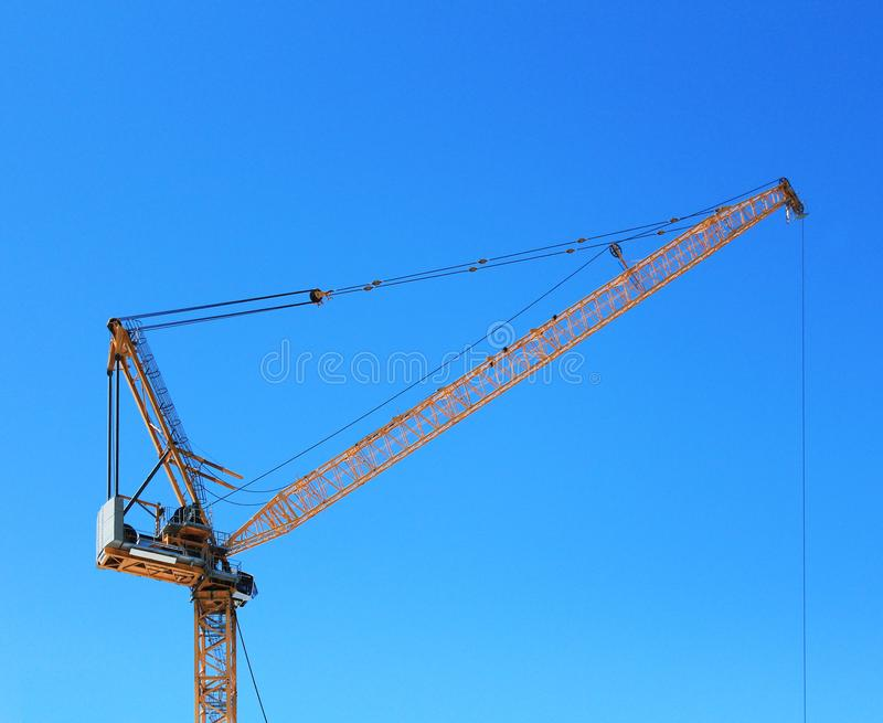 Yellow Construction Crane with Blue Sky royalty free stock photos