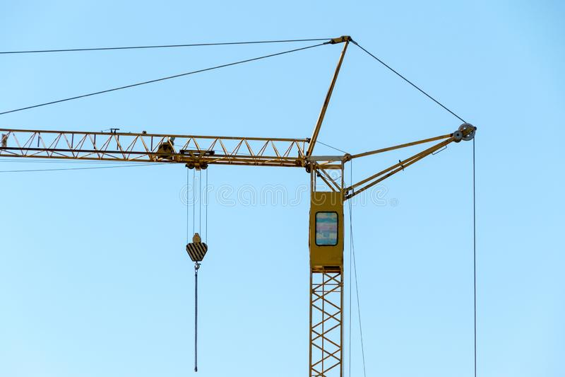 Yellow construction crane and blue sky royalty free stock photos
