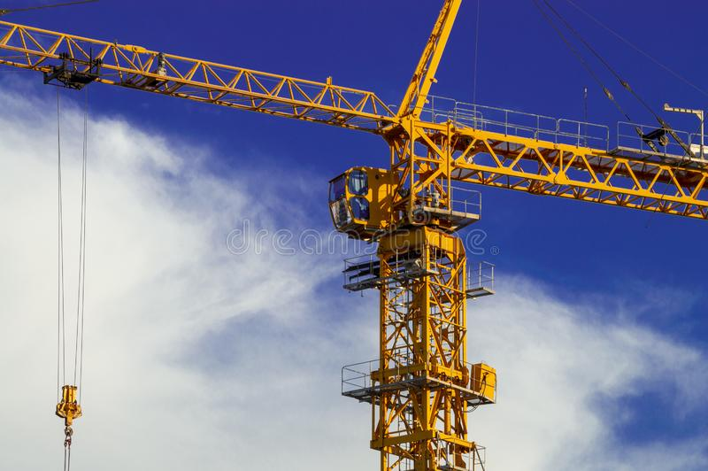Yellow construction gantry crane on a construction site. Bottom view royalty free stock image