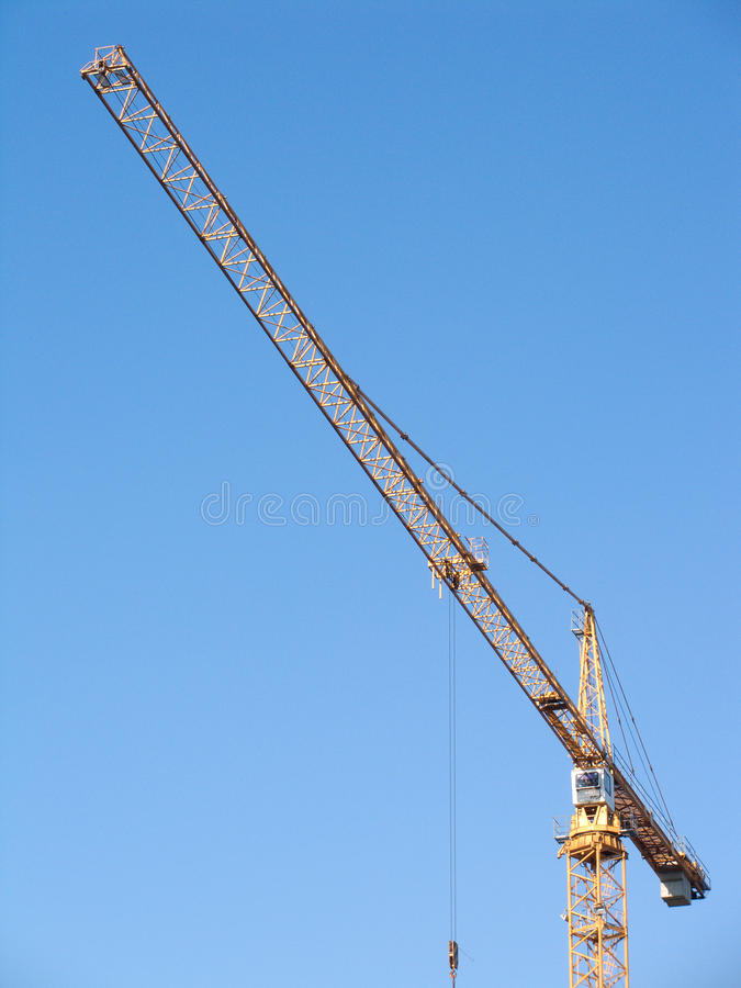 Download Yellow Construction Hoisting Crane On Clear Sky Stock Image - Image: 19748561