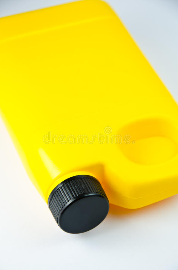 Yellow container. Close up of a yellow container on white background royalty free stock image