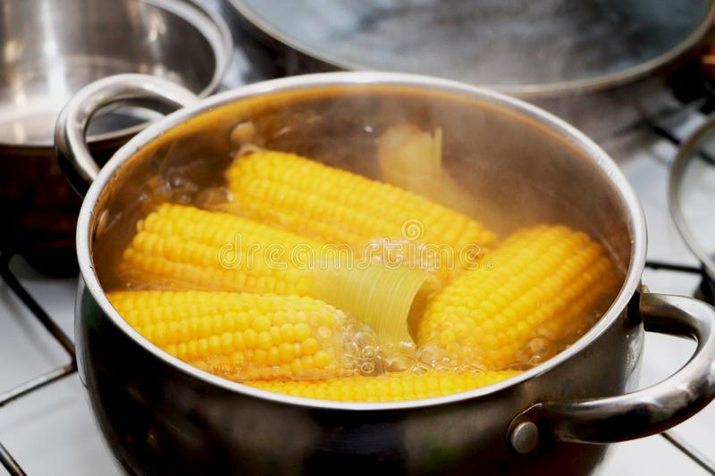 Yellow corn stew in a saucepan. Flavored dinner royalty free stock photos