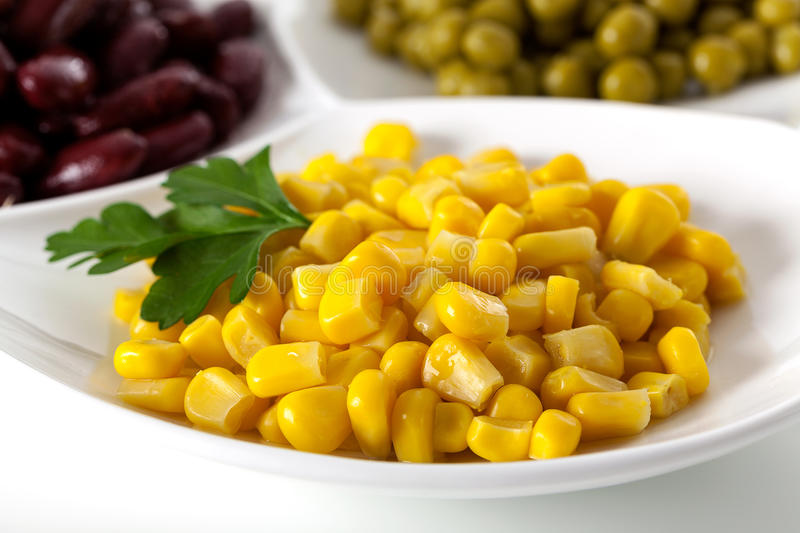 Yellow corn on white plate royalty free stock images