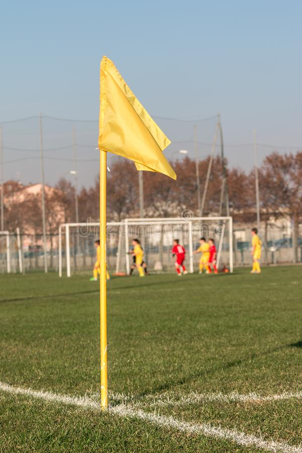 Yellow Corner Flag in Soccer Field during Children League Match.  royalty free stock image