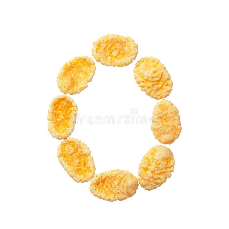 Yellow cornflakes letter O or number 0 zero isolated on white background. Alphabet cereal flakes royalty free stock image