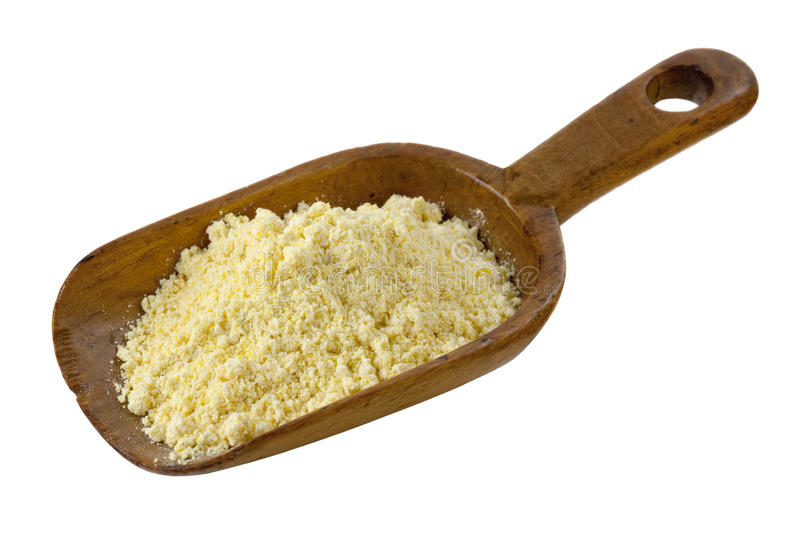 Yellow cornmeal. On a rustic wooden scoop isolated on white stock image