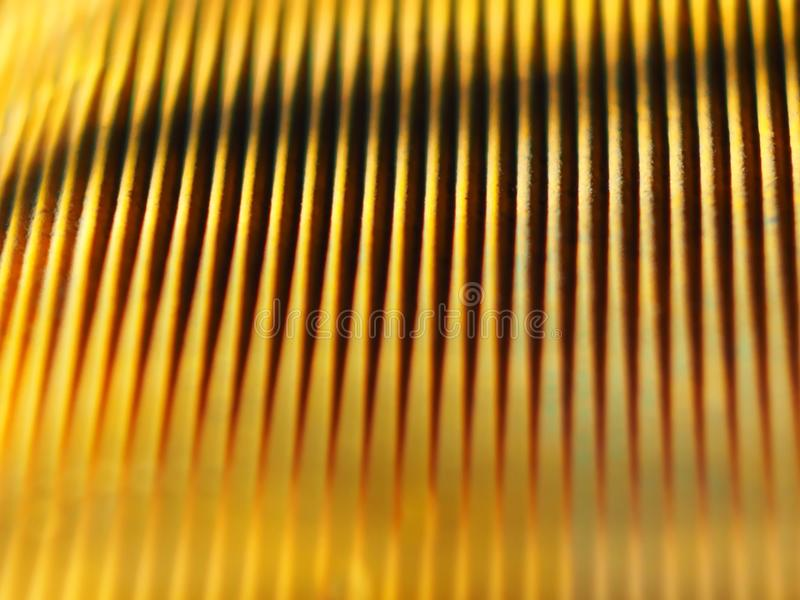Yellow corrugated paper interesting texture. From the shade of the strip caused by the lighting of the sun yellow paper interesting substrate under the text or royalty free stock photography