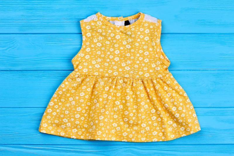 Yellow cotton dress for newborn. royalty free stock photography