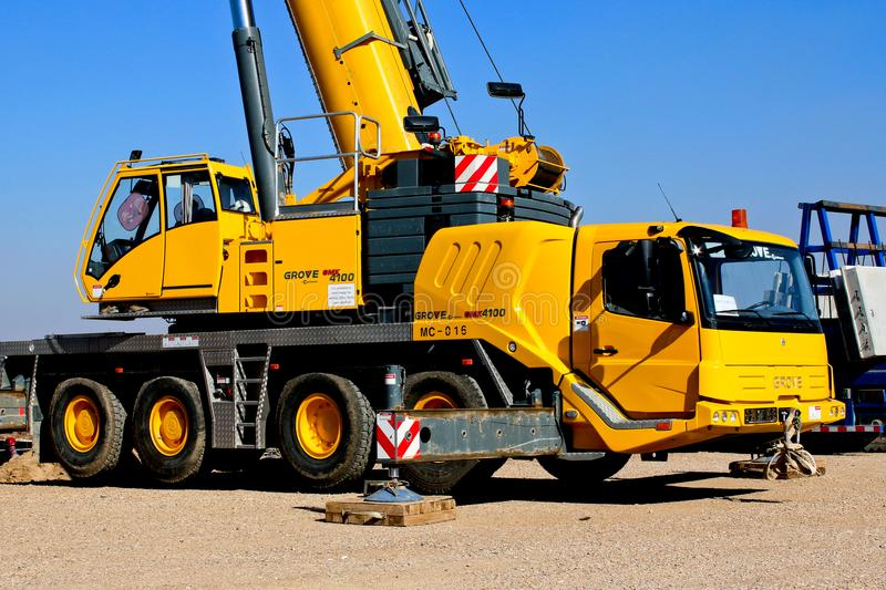 Yellow Crane Truck Parked on Brown Field royalty free stock photo