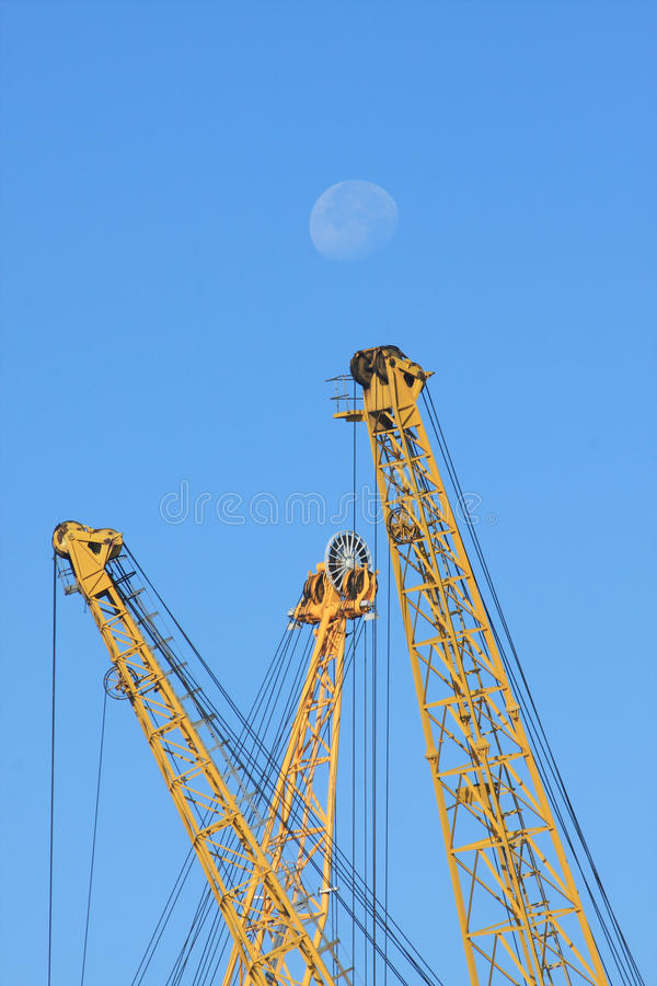 Yellow Cranes And Blue Sky Stock Photo