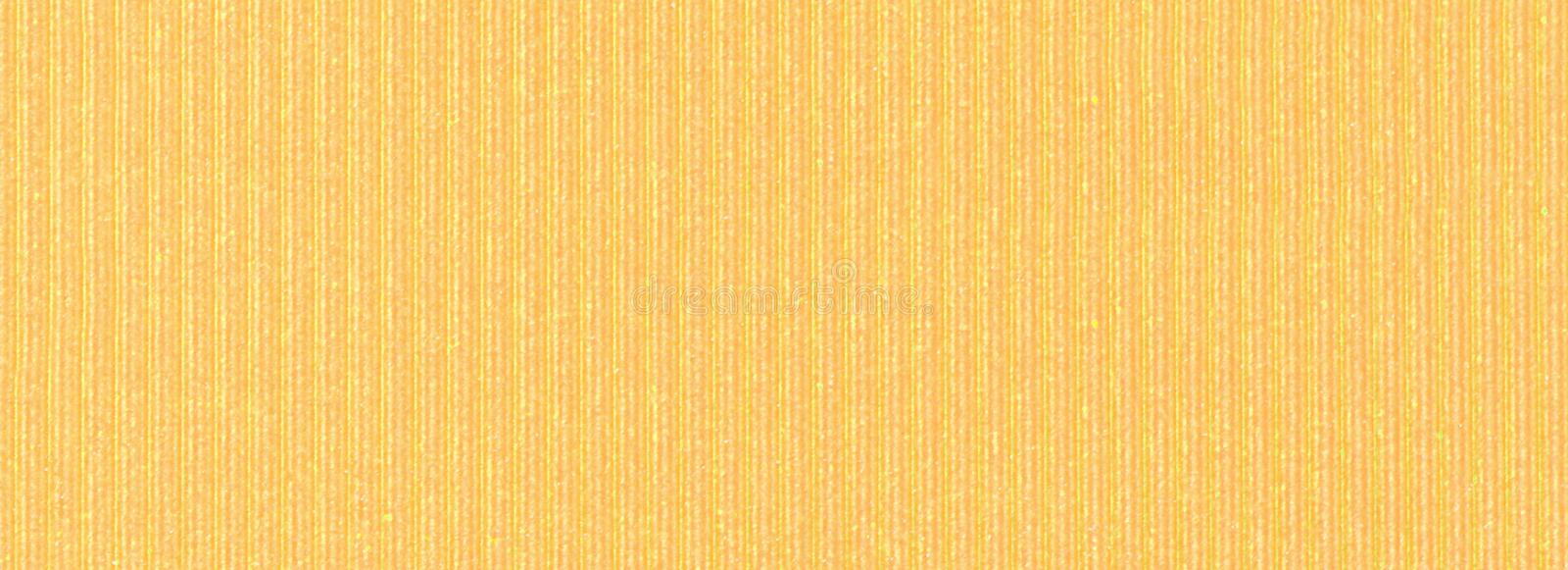 Yellow crepe paper close up. The yellow crepe paper close up. Macro stock images