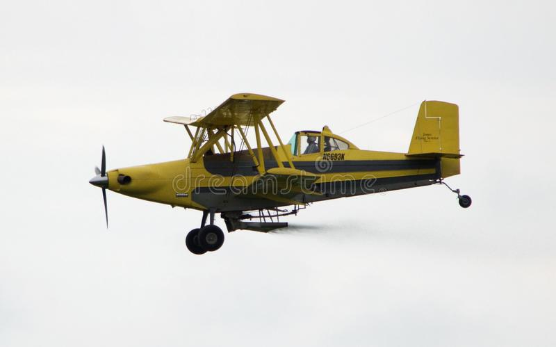 Crop duster fly by stock photo