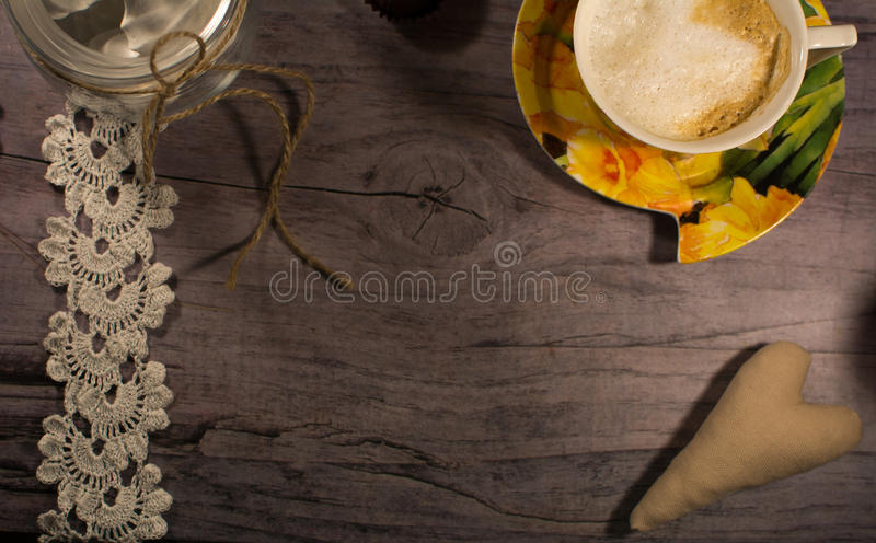 Yellow cup of coffee on the gray table . Romantic background. royalty free stock photos