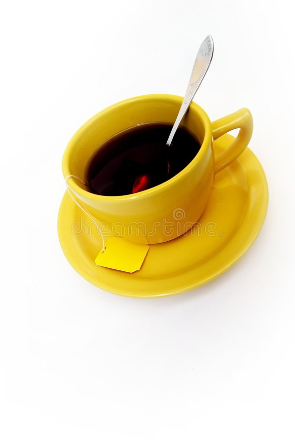 Yellow cup of tea royalty free stock photo
