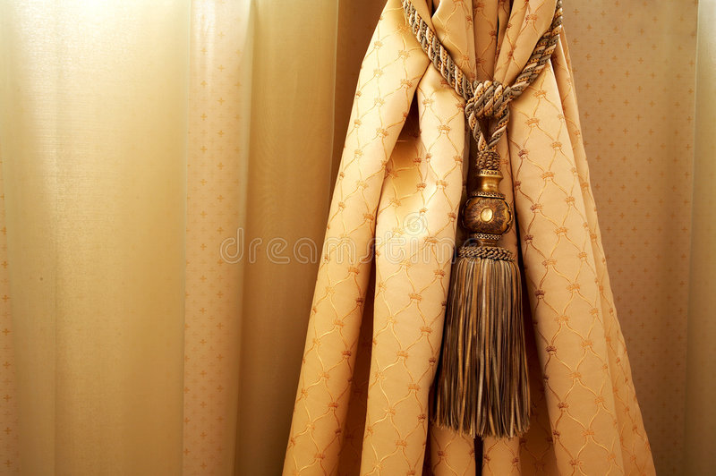 Yellow curtain. With ornaments in the modern house stock image