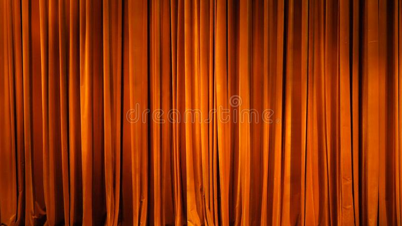 The yellow curtain. Theatrical scenes with light from the spotlights in the closed position.  royalty free stock photo