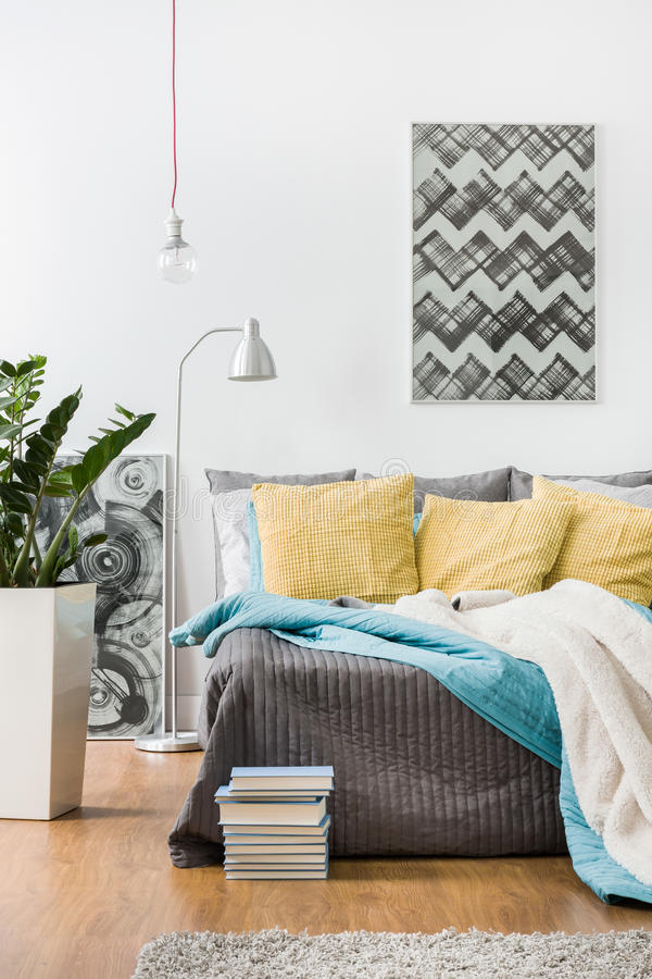 Free Yellow Cushions And Gray Bedspread Royalty Free Stock Photos - 64984758