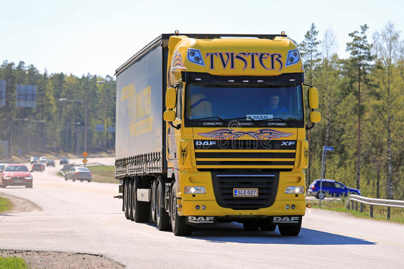Yellow DAF XF Tvister Truck on Road stock photo