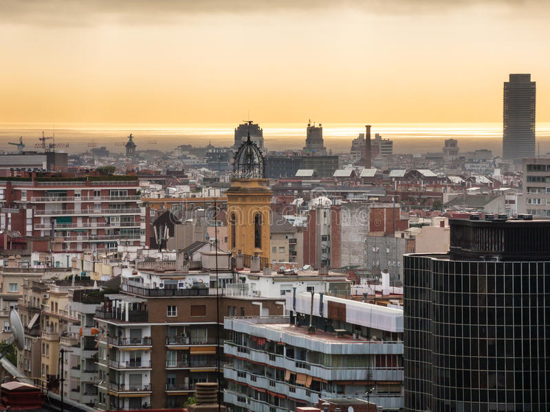 Yellow dawning over Barcelona in spring. Yellow dawning over Barcelona city in spring stock photography